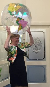 EM with globe on her head at World Homeshare Congress 6 Nov 15