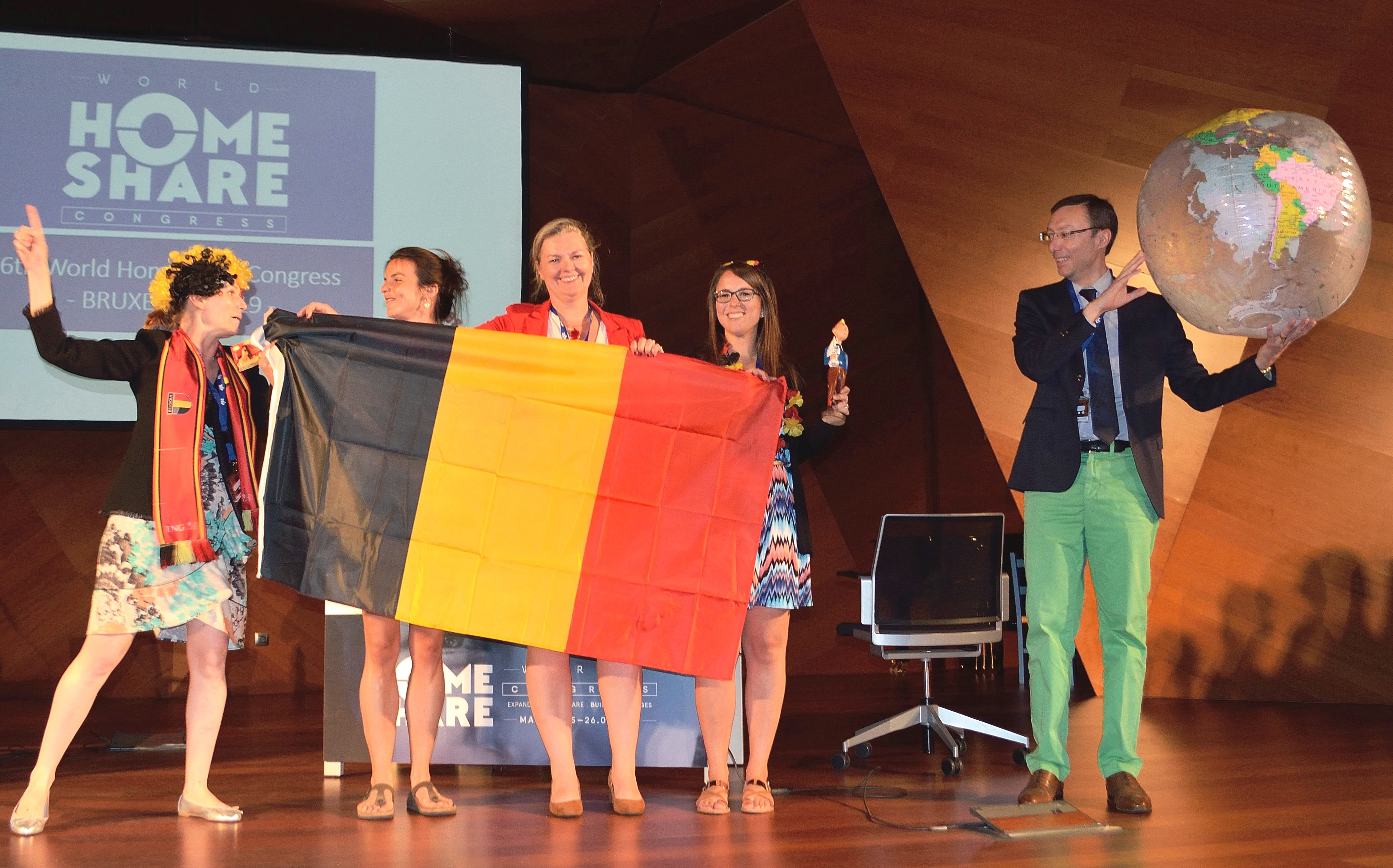 The globe is passed to Belgium who will host the Homeshare International Congress in 2019
